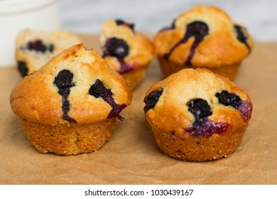 Close up fresh homemade gluten free blueberry muffin on brown pergamen paper