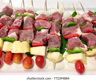 Close up fresh meat and vegetables skewer on bamboo wood place on white dish prepare for celebrate in holidays or party's, barbecue, grill, cooking.