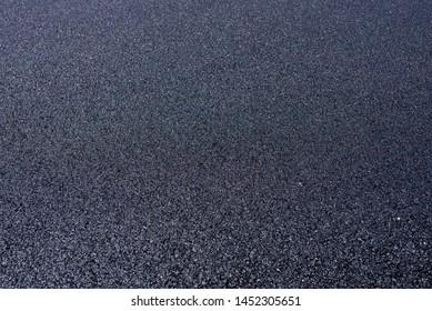 Close up of fresh new asphalt pavement