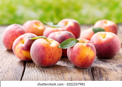 close up of fresh peaches on a wooden table