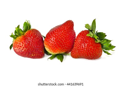 Close up of fresh ripe strawberries isolated on white background, selective focus.
