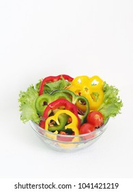 Close up fresh vegetables over white background.