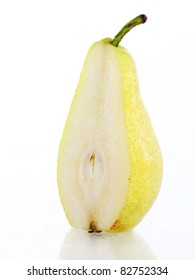 Close up of fresh and wet pear fruit over white background