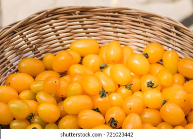 close up fresh yellow cherry tomat in basket.