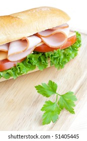 Close up of freshly made sandwich on wooden board
