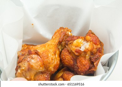 Close up of fried chicken in oil absorbing paper.