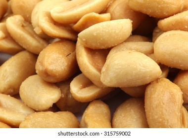 Close up of fried, peeled and salted peanuts.