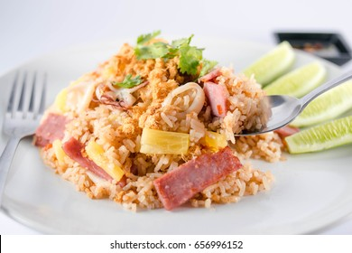 Close up Fried rice with pineapple, stir fried rice with pineapple fruit, eggplant, seasoned with . pepper, seasoning with pepper The taste is not spicy,The sour and sweet taste of pineapple.