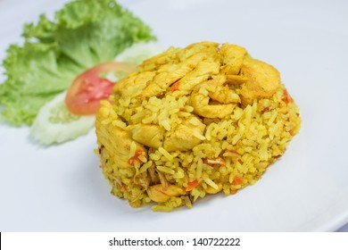 close up fried rice with yellow ginger with chicken, Thai food on white dish