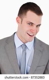 Close up of friendly businessman on white background