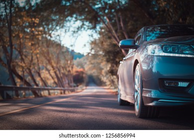 Close up front bumper of old gray car parking on the asphalt road,The image in front of the sports car scene,copy space.transport concept,filter color effect.
