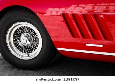 close up front left of a vintage red sports car