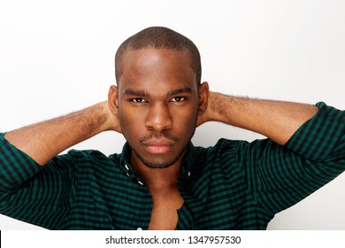 Close up front portrait of handsome young african american man with serious expression against isolated white background