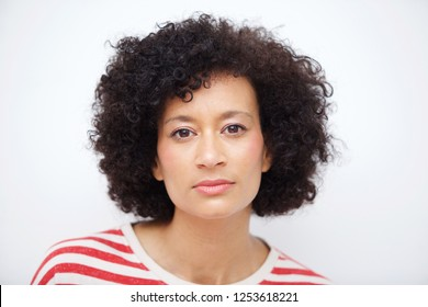 Close up front portrait of and older african american woman against white wall