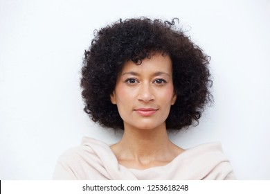 Close up front portrait of and older african american woman against white background
