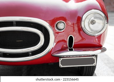 close up of front of a red vintage car