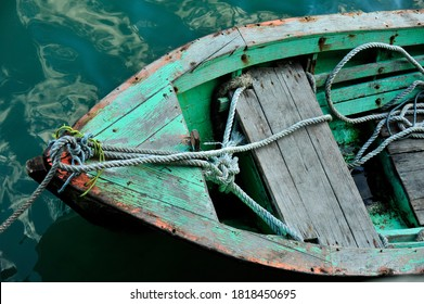 Close up of front side of small fisherman wooden boat moored in port. located at Terengganu, Malaysia.