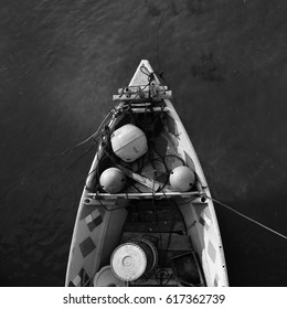 Close up of front side of small fisherman boat moored in port. small row boat floating , black and white photography