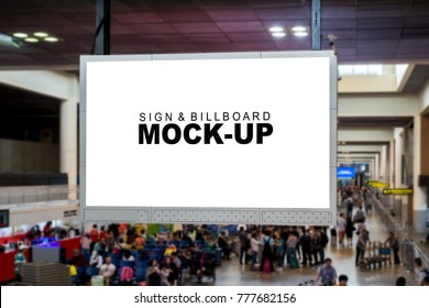 Close up of front view the mock up and Blank white screen for advertising or information hanging from ceiling over the airline passengers area in airport terminal, with clipping path