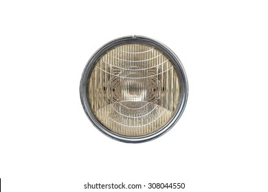 Close up front view of round car headlight, isolated on white background.