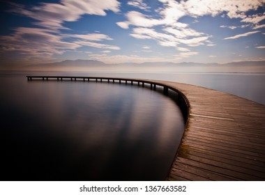 Close up front view of wooden curved long deck pier or dockage in circular angle on the sea in Sekapark, Izmit, Kocaeli, Turkey. Artifical natural park near seacoast.