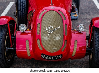 Close up of front of vintage red Alfa Romeo sports car taken in Bournemouth, Dorset, UK on 31 May 2015