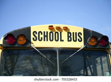 Close up of the front of a yellow school bus