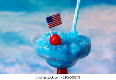 close up of a frozen Blue Hawaiian drink made with coconut cream, blue Curacao, pineapple juice and rum