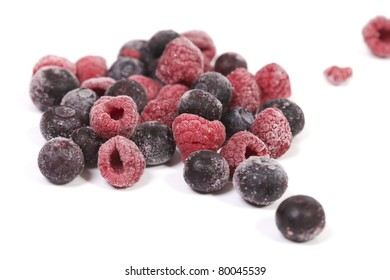 Close up of frozen blueberries and raspberries