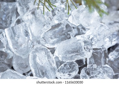 Close up of frozen ice cubes scattered on a pot as a textured background