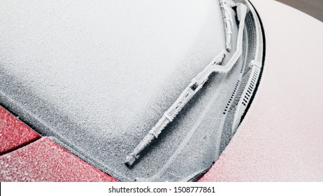 Close up of frozen windshield and car wiper in winter