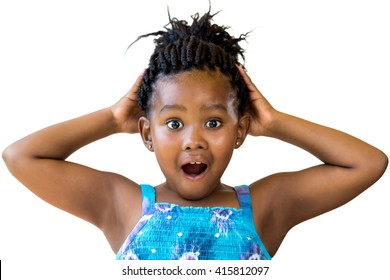 Close up fun portrait of cute black girl with hands on head.Youngster with open mouth and shocking facial expression isolated on white background.