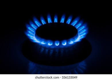 Close up of a gas burner on black background