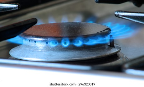 Close up of a gas stove blue flame