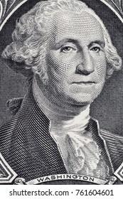 Close up to George Washington portrait on one dollar bill.