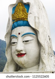 close up of the giant Guanyin statue outside of Keh Lok Si buddhist temple in Penang, Malaysia