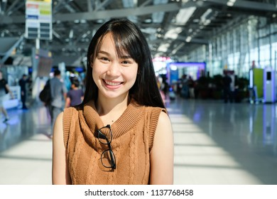 Close up the girl with brown sleeveless and glasses at suvarnabhumi airport. Thailand