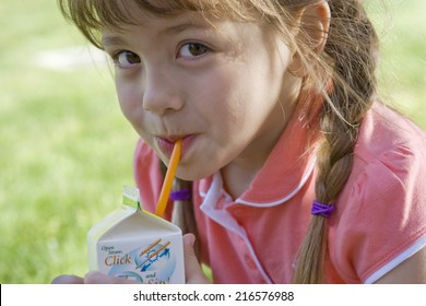 Close up of girl drinking juice from box