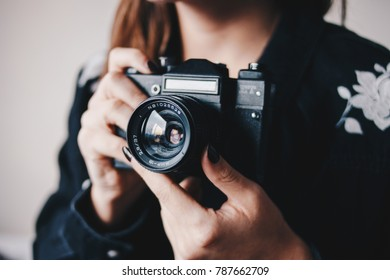 Close up of a girl holding vintage film camera