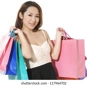 close up girl with shopping colorful bag