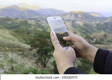 Close up of a girl using mobile smart phone take photography