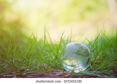 close up glass global on green grass with copy space background for text, earth day, world environment day concept - Shutterstock ID 1072431530