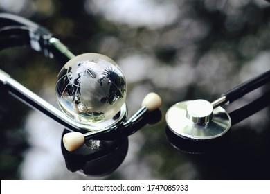 close up glass globe and stethoscope on table, world health day, medical and healthcare, 2019-ncov risk and problem, coronavirus covid-19warning, global pandemic and telemedicine business technology
