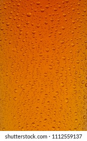 A close up of a glass of Indian Pale Ale, showing texture of the condensation