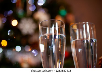 Close up of glasses with christmas lights in the background