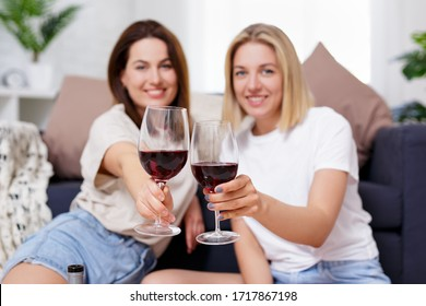 close up of glasses of red wine in female hands
