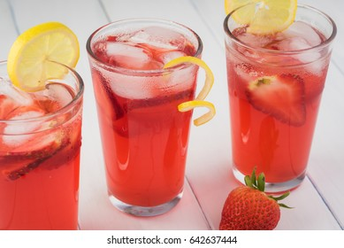Close up of glasses with strawberry rhubarb lemonade.