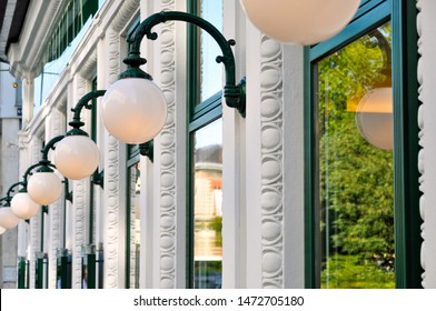 A close up of globe light fixtures along the facade of a building in downtown Vienna creates an interesting pattern and an architectural abstract.