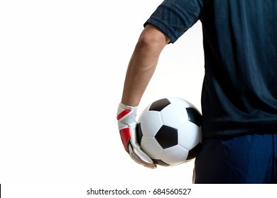 close up goalkeeper holding soccer ball in the studio