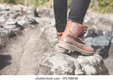 Close up of going legs on path , hiking shoes in action on a mountain